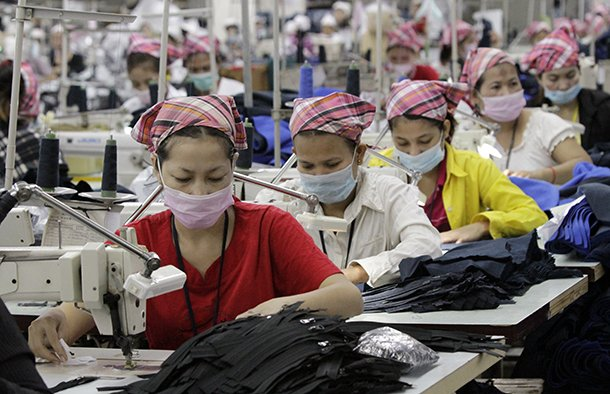 Employees work at a garment factory in Phnom Penh, Cambodia. (Photo: Reuters)