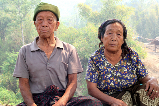 Lazum Htang, left, and his wife, Gaw Lu Hkang, at the Nhkawng Pa IDP camp in Momauk Township, Kachin State. (Photo: Seamus Martov / The Irrawaddy)