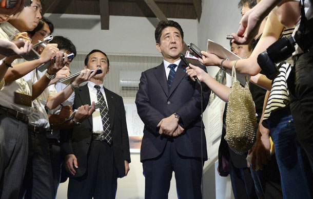 Japan's Prime Minister Shinzo Abe speaks to the media after visiting a shopping street in Shimonoseki, western Japan, in this photo taken by Kyodo on Aug. 13, 2014. (Photo: Reuters / Kyodo)