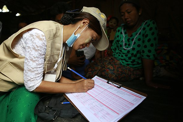 A volunteer collects census data in Arakan State. (Photo: Reuters)