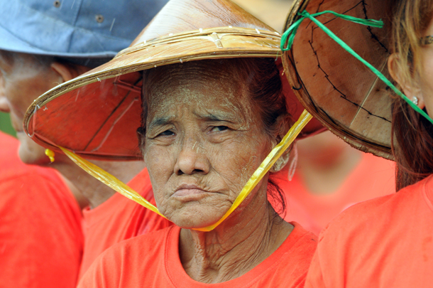 A Burmese farmer frowns during a demonstration in July 2013 near Sule Pagoda in downtown Rangoon to protest ongoing and past land confiscations. (Photo: Steve Tickner / The Irrawaddy)