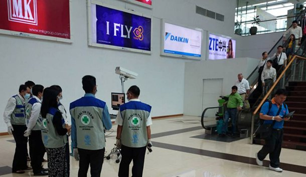 The Ministry of Health's rapid response team conducts thermal-imaging checks on passengers arriving at Rangoon International Airport. (Photo: Myanmar Center for Disease Control and Prevention)