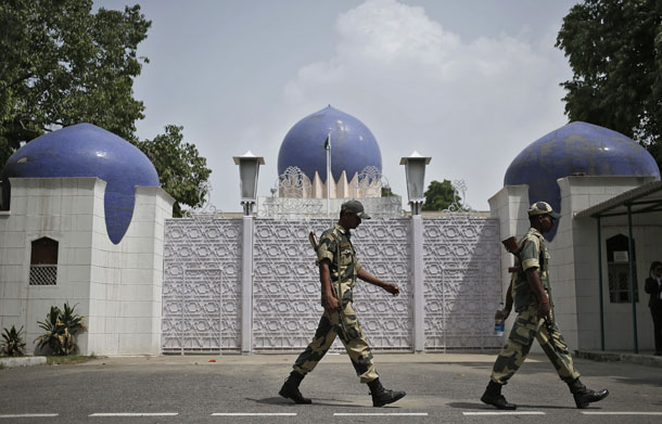 Indian security personnel walk past the main gate of Pakistan High Commission in New Delhi on Aug. 19. (Photo: Reuters)