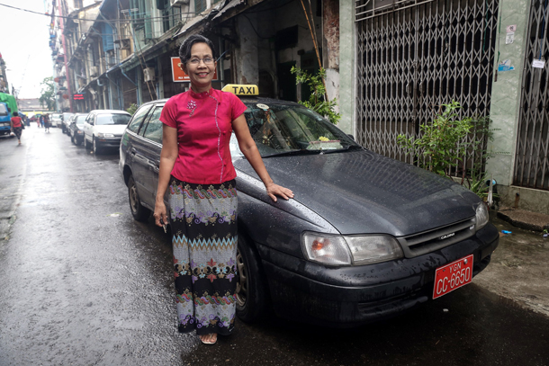 Daw Ni Ni Shein reckons driving is a good job. (Photo: Simon Roughneen / The Irrawaddy)
