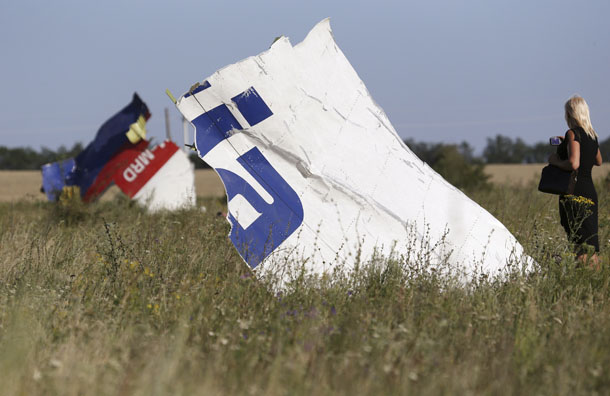 A woman takes a photograph of wreckage at the crash site of Malaysia Airlines Flight MH17 near the village of Hrabove (Grabovo), Donetsk region July 26, 2014. (Photo: Reuters)
