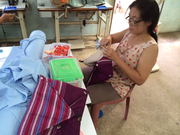 Ma Yin Nu sews a computer bag at a shelter for people with HIV in Mae Sot. (Photo: Nyein Nyein / The Irrawaddy)