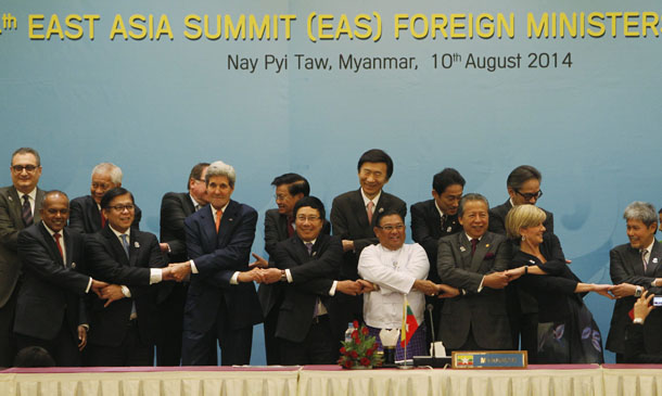 Foreign dignitaries hold hands as they pose for a photo before the 4th East Asia Summit Foreign Ministers' meeting at the Myanmar International Convention Centre in Naypyidaw on Sunday. (Photo: Reuters)