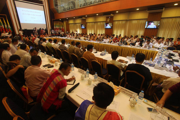About 150 representatives from 66 political parties attended the meeting with President's Office Minister Aung Min and other members of the government's Union Peacemaking Working Committee (UPWC) at the Myanmar Peace Center (MPC) on Monday. (Photo: Myanmar Peace Center / Facebook)