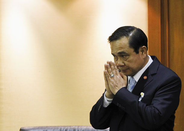 Thai Army chief Gen. Prayuth Chan-ocha gestures in a traditional greeting during the start of a National Legislative Assembly meeting at parliament in Bangkok on Aug. 18, 2014. (Photo: Reuters / Chaiwat Subprasom)