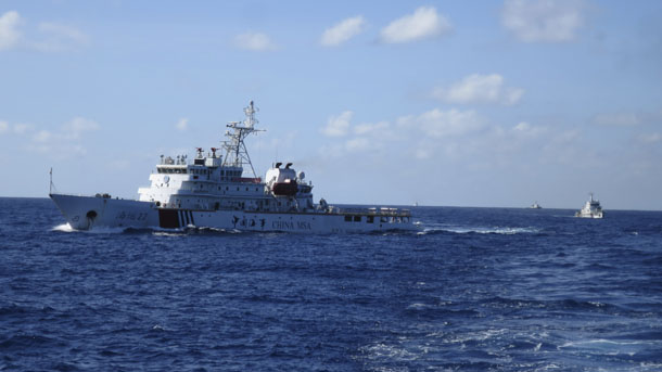 Chinese coastguard ships give chase to Vietnamese coastguard vessels (not pictured) after they came within 10 nautical miles of the Haiyang Shiyou 981, known in Vietnam as HD-981, oil rig in the South China Sea July 15, 2014. (Photo: Reuters)