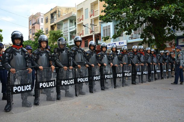 Police in riot gear stand guard at Joon Mosque in central Mandalay during inter-communal unrest last month. (Photo: The Irrawaddy)