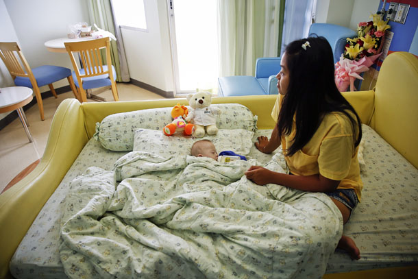 Gammy, a baby born with Down's Syndrome, is fed by his surrogate mother Pattaramon Janbua at a hospital in Chonburi province on Aug. 3, 2014. (Photo: Reuters / Damir Sagolj)