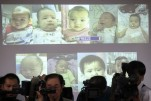 Surrogate babies that Thai police suspect were fathered by a Japanese businessman who has fled from Thailand are shown on a screen during a news conference at the headquarters of the Royal Thai Police in Bangkok August 12, 2014. (Photo: Reuters)