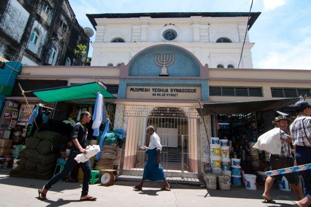 A man walks past the Musmeah Yeshua Synagogue on 26th street in downtown Rangoon. (Photo: Sai Zaw / The Irrawaddy)