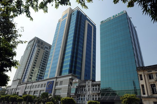 A bank and office buildings are seen in downtown Rangoon. Companies are struggling to find affordable office space in Burma's biggest city, with property in short supply and rental prices high. (Photo: Steve Tickner / The Irrawaddy)