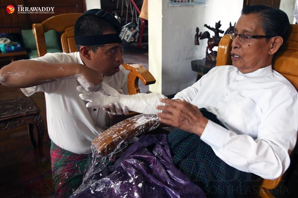 Tin Oo, patron of the National League for Democracy, has a plaster cast of his arm made by the artist Htein Lin. (Photo: Hein Htet / The Irrawaddy)