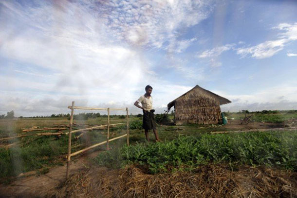 A man looks at his watermelon field near the Thilawa economic zone outside Rangoon in October 2012. (Photo: Reuters)