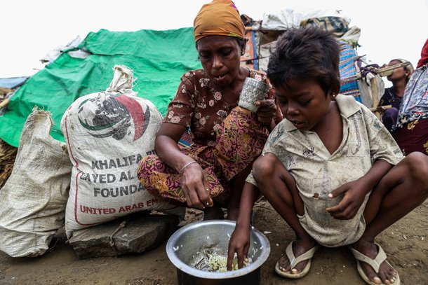 A Rohingya family have a meager meal in a camp for displaced Muslim families in May 2013. (Photo: Jpaing / The Irrawaddy)