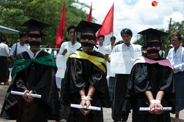 Blindfolded students wearing graduation gowns protest against the National Education Bill on the campus of Dagon University in Rangoon in early September. (Photo: Sai Zaw / The Irrawaddy)