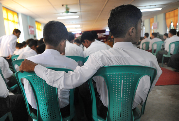 Former child soldiers attend a discharge ceremony in Rangoon on Thursday. (Photo: Steve Tickner / The Irrawaddy)
