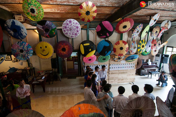 Parasols up for auction are displayed at Pansodan Scene in downtown Rangoon. (Photo: Sai Zaw / The Irrawaddy)