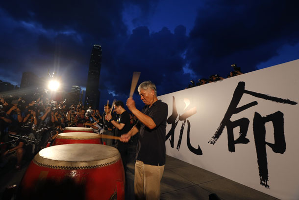 "Founders of the Occupy Central civil disobedience movement (right to left) Reverend Chu Yiu-ming, academics Benny Tai and Chan Kin-man hit drums in front of Chinese characters ""disobedience,"" during a campaign to kick off the movement in front of the financial Central district in Hong Kong on August 31, 2014. (Photo: Reuters)"