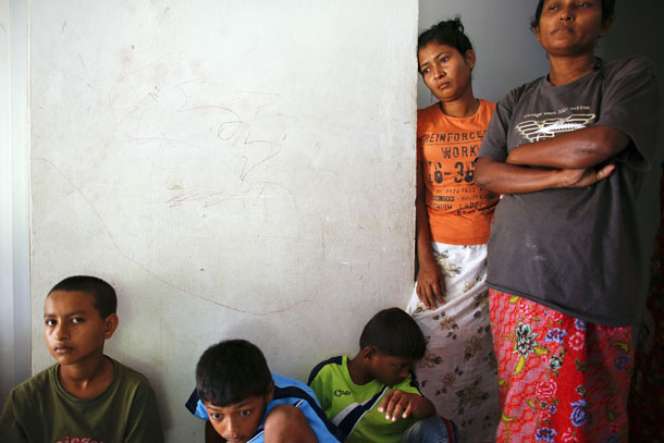 Rohingya women and children who arrived by boat from Burma pass the time at a closed shelter in Phang Nga, Thailand, in October 2013. (Photo: Reuters)