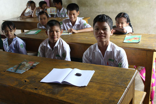 Saw Myint Aung, 13, right, is a top student for English language at a government school in Htee Kaw Htaw, Myawaddy Township. (Photo: Samantha Michaels / The Irrawaddy)