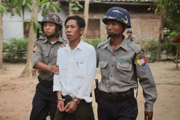 Farmer and activist Pauk Sa is led by police in Pegu Division's Paungtae Township following a land rights protest in May. (Kaung Myat Min / The Irrawaddy)