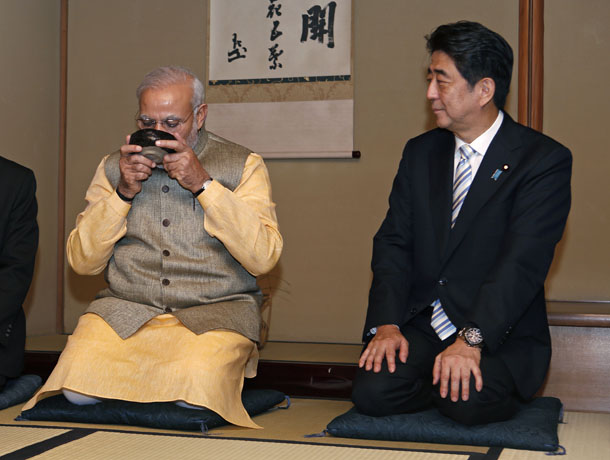 India's Prime Minister Narendra Modi (left) enjoys a cup of green tea next to Japan's Prime Minister Shinzo Abe during a tea ceremony at the Omotesenke, one of the main schools of Japanese tea ceremony, in Tokyo Sept. 1, 2014. (Photo: Reuters)