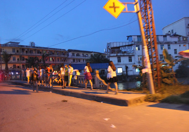 Female sex workers solicit passersby on a bridge in Mong La, eastern Burma. (Photo: Nang Seng Nom / The Irrawaddy)