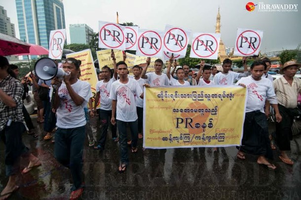 Activists march near Rangoon's Sule Pagoda on Aug. 5, 2014, to oppose a proposal to change the way Burma elects its lawmakers to proportional representation.