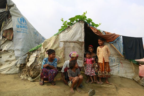 A family sits in front of their temporary shelter at a Rohingya refugee camp in Sittwe, Arakan State, on April 2, 2014. (Photo: Reuters)