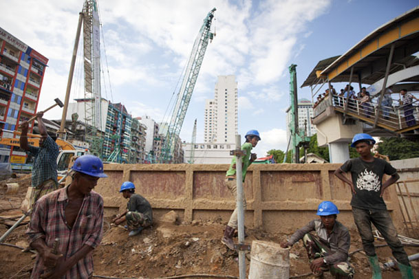 Laborers work at a construction site in downtown Yangon. (Photo: Reuters)