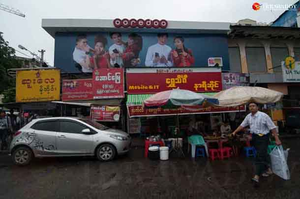 An Ooredoo banner advertisement is displayed in downtown Rangoon. (Photo: Sai Zaw / The Irrawaddy)
