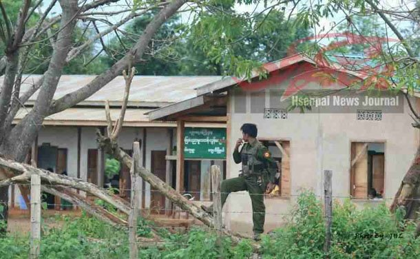 A government soldier stands outside a primary school in Wan Wap village in Kyaethee Township on July 16. Residents have complained that government troops have occupied half the homes on the village. (Photo: Hsenpai News Journal / Facebook)