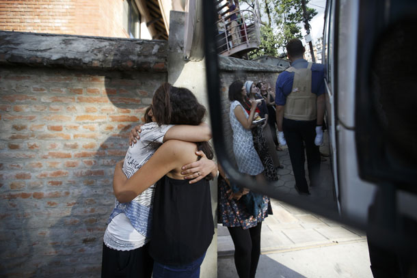 Israeli survivors from the blizzard hug each other, as they get ready to board a bus to the airport to head back to their country in Kathmandu October 18, 2014. (Photo: Reuters)