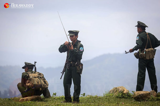 A TNLA officer talks on his radio about Burmese troop deployments at the frontline near Lwel Khan village in Kyauk Mae Township, northern Shan State, July 2014. (Photo: JPaing / The Irrawaddy)