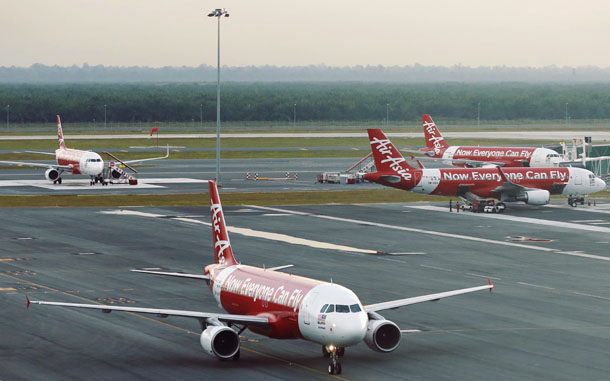 AirAsia planes are seen on the runway at Kuala Lumpur International Airport on Aug. 19, 2014. (Photo: Reuters)