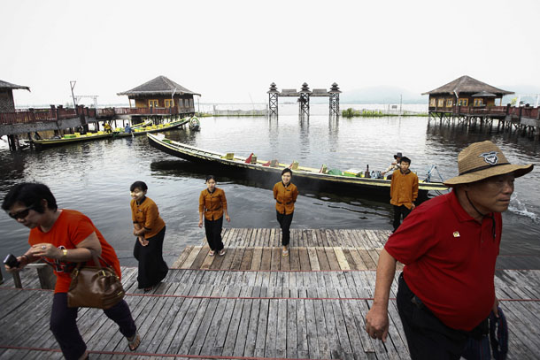 Tourists arrive to a hotel located on Inle Lake, one of the main tourist attractions in Burma, on Sept. 25, 2013. (Photo: Reuters / Minzayar)