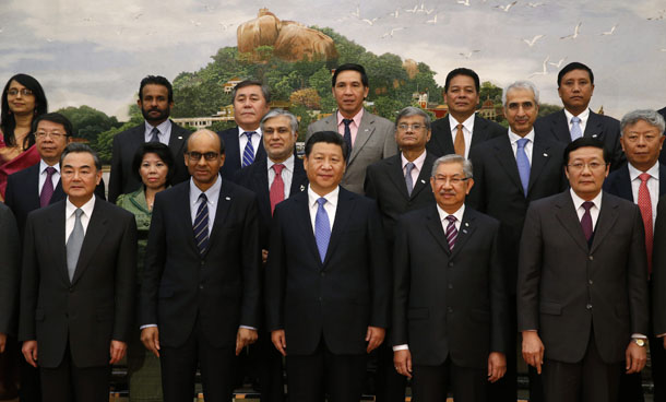 China's President Xi Jinping, front center, poses for photos with guests at the Asian Infrastructure Investment Bank launch ceremony at the Great Hall of the People in Beijing on Oct. 24, 2014. (Photo: Reuters)