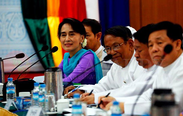 Aung Thaung (with glasses) sits next to Aung San Suu Kyi at a meeting in Rangoon last year. (Photo: JPaing / The Irrawaddy)