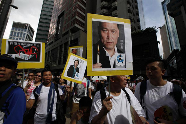 Protesters carry a portrait of detained Chinese human rights lawyer Pu Zhiqiang in Hong Kong on Jul. 1. (Photo: Bobby Yip / Reuters)
