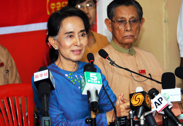 Opposition leader Aung San Suu Kyi, flanked by NLD patron Tin Tun Oo, addresses the media during a press conference at the NLD's Rangoon headquarters on Wednesday. (Photo: Steve Tickner / The Irrawaddy)