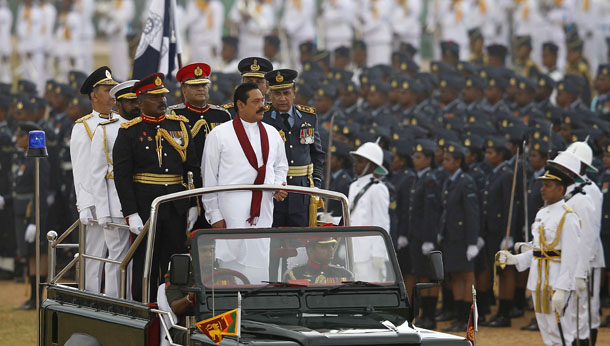 Sri Lanka's President Mahinda Rajapaksa (in white) inspects a parade during the War Victory parade, in Colombo May 18, 2013.