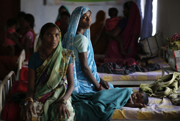Kekti Bai (C), who underwent surgery at a government mass sterilization camp, watches while other women sit inside a hospital at Bilaspur district in the eastern Indian state of Chhattisgarh on Nov. 15, 2014. (Photo: Reuters)