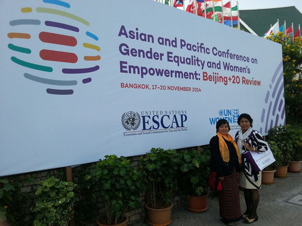 Women's activists Shwe Shwe Sein Latt, left, and Nyo Nyo Thin stand in front of a banner for the Asia-Pacific Conference on Beijing+20 in Bangkok. (Photo: Facebook / Shwe Shwe Sein Latt)