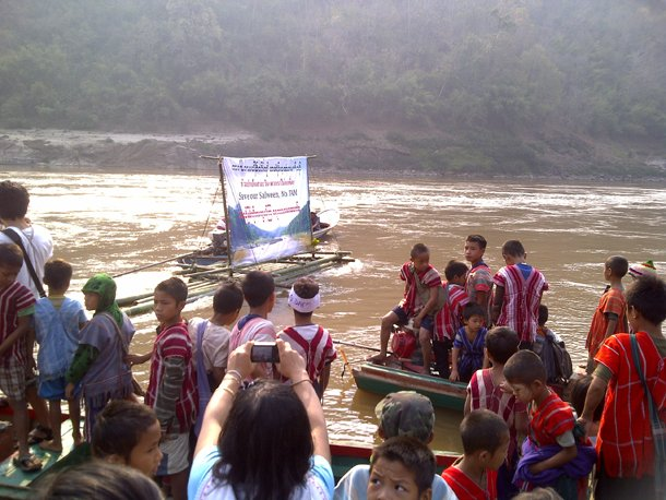 Karen communities calling for the protection of the Salween River release a bamboo raft on the river in Papun District, Karen State, in March 2013. (Photo: Karen Rivers Watch)