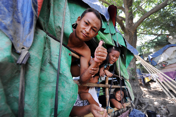 Inhabitants of one of the many improvised huts around Gaw Lein Jetty, which have been demolished ahead of a visit by the Norwegian royal family. (Photo: Steve Tickner / The Irrawaddy)