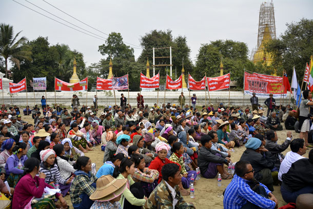 Participants at a rally in Mandalay Friday listen to speeches calling for democratic reforms and better land rights protection. (Photo: Teza Hlaing)